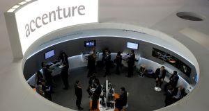 Accenture has chalked out $1.8 billion for acquisitions in digital, cloud and security-related services in the fiscal year. Photograph: Albert Gea/Reuters