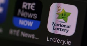 Gambling app: opening the lotto to an online audience has coincided with fierce competition from websites like Lottoland and Jackpot.com. Photograph: Nick Bradshaw