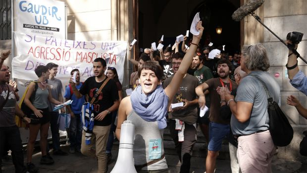 Students shout slogans and wave Catalan referendum voting cards during a demonstration called for by the Catalan National Assembly and Omnium Cultural outside the University of Barcelona. Photograph: Pau Barrena/Bloomberg