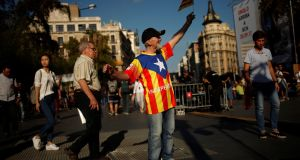Josep Maria Belver (77) wears a shirt with the colors of a separatist flag as he sings the Catalan anthem before a political meeting in favour of the independence referendum outside the University of Barcelona. Photograph: Jon Nazca/Reuters