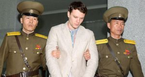Otto Frederick Warmbier (C), a University of Virginia student  is taken to North Korea's top court in Pyongyang in March, 2016. Photograph: Kyodo/Reuters