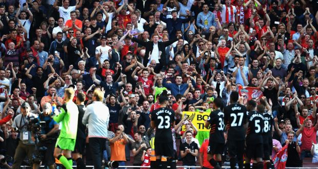 eff726e74a Liverpool fans celebrate after their clash with Arsenal at the Emirates  last season. Photo