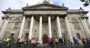 Members of the public cycling past the Four Courts in support of the  Liffey Cycle Route earlier this month. Photograph Nick Bradshaw