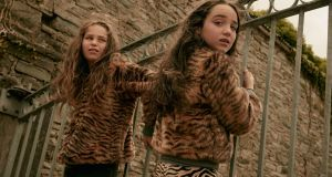 Tilly faux fur tiger coat, €150, with Lillian tiger print knit trousers, €90. Photograph: Ronan Gallagher