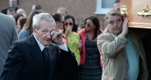 One of the Birmingham Six, Paddy Hill, wipes a tear as the coffin of Gerry Conlon is carried into St Peter's Cathedral, Belfast,  for a requiem mass on June 28th, 2014. Photograph: Charles McQuillan/Getty Images