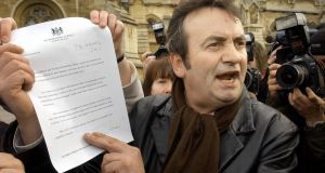 Gerry Conlon faces the media showing them the letter of apology he received from British prime minister Tony Blair for being wrongly convicted of the Guildford pub bombings. Photograph: Stefan Rousseau/PA