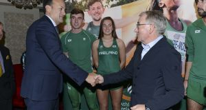 Taoiseach Leo Varadkar with Shane Aston (decathlon), Ciara Neville (60m),  CX+Sport chief executive Tom MacGuinness and Mick Clohisey (marathon) at the unveiling  of the latest Athletics Ireland team kit