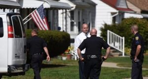 Police outisde a home where two children were shot in Dearborn, Michigan.  Photograph: Tanya Moutzalias/AP