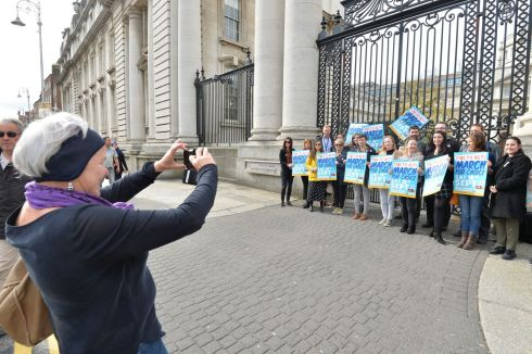 EMPLOYEES FOR CHOICE: People Before Profit TD Brid Smith takes a picture of members of the Oireachtas Employees for Choice group gathered outside the Department of the Taoiseach. Photograph: Alan Betson/The Irish Times