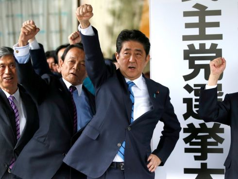 ABE'S PLEDGE: Japanese prime minister Shinzo Abe (third left) and party members raise fists as they pledge electoral victory in the upcoming lower house election at their party headquarters in Tokyo, Japan. Photograph: Toru Hanai/Reuters