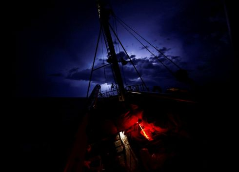LIBYAN LIGHTNING: Search-and-rescue vessel MV Seefuchs of the German non-governmental organisation Sea-Eye in a lightning storm in international waters off the coast of Libya. Photograph: Darrin Zammit Lupi/Reuters