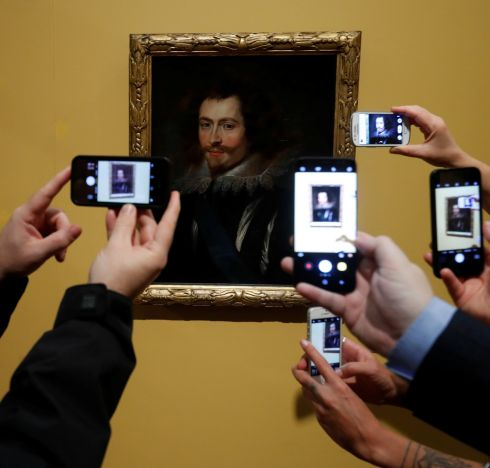 RUBENS MASTERPIECE: People take pictures on mobile phones of the lost Rubens masterpiece entitled George Villiers, on show at Kelvingrove Museum, Glasgow, Scotland. Photograph: Russell Cheyne/Reuters