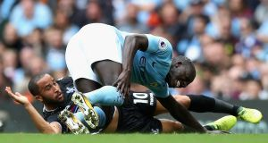 Benjamin Mendy goes down under a challenge from Crystal Palace's Andros Townsend. Photo: Manchester City FC/Manchester City FC via Getty Images