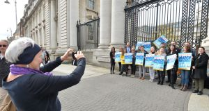 Bríd Smith TD takes a picture of the members of the Oireachtas employees for choice gathered outside the Department of the Taoiseach. Photograph: Alan Betson