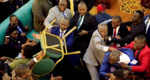 Ugandan lawmakers involved in a fight in the parliament ahead of proposed age limit amendment bill debate. Photograph:  James Akena/Reuters