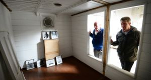 Joe O'Farrell (left) of the Shackleton Museum Athy and Sven Habermann of Conservation Letterfrack peer into the cabin in which the explorer died in the Antartic on January 5th, 1922. Photograph: Bryan O'Brien