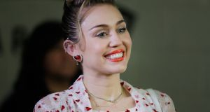 For Miley Cyrus, 'the dreadlocks and gold grill are gone, replaced with pigtails, pink dresses and puppet shows'. Photograph:  Isaac Brekken/Getty Images