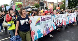 Abortion rights campaigners pass along the quays as part last year's March for Choice. The 2017 event takes place in Dublin on Saturday. Photograph: Eric Luke