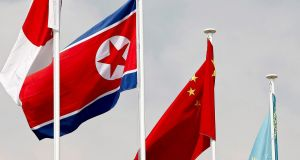 The North Korean and Chinese flags: The Korean nuclear crisis has put China in an awkward position and Beijing repeatedly emphasises its stance calling for talks. Photograph: Jeon Heon-Kyun/EPA