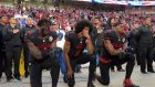 San Francisco 49ers outside linebacker Eli Harold (58), quarterback Colin Kaepernick (7) and free safety Eric Reid (35) kneel in protest during the playing of the national anthem before a NFL game against the Arizona Cardinals in Santa Clara, California, in October 2016. Photograph: Kirby Lee