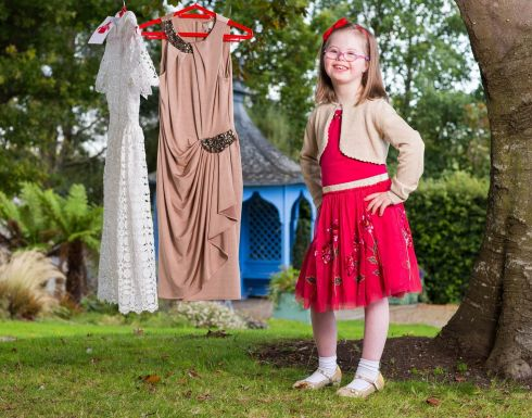 DRESSED FOR SUCCESS: Ava Leahy with some of the dresses for sale at Buy My Dress, in aid of the Down Syndrome Centre, on Saturday, September 30th, in Dublin, Galway, Cork and Portlaoise. Photograph: Conor Healy