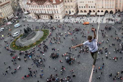 AWARENESS RAISING: A participant balances on a slackline over the old town square in Prague during a campaign to support people with diabetes. Photograph: Martin Divisek/EPA