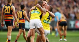 Jack Riewoldt of the Tigers celebrates victory with team mates at the final siren during the 2017 AFL Grand Final. Photograph: Getty Images
