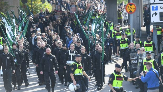 Nordic Resistance Movement marchers in central Gothenburg, Sweden, September 30th, 2017. Photograph: Fredrik Sandberg/TT News Agency/Reuters