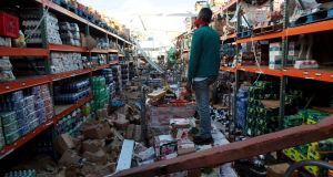 Major task ahead: A man surveys a destroyed supermarket  in Salinas, Puerto Rico, after Hurricane Maria. Photograph: Alvin Baez/Reuters