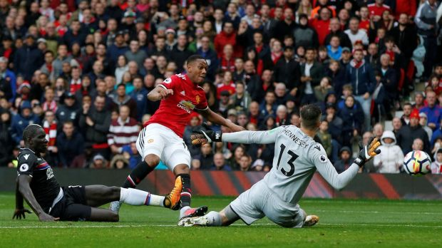 Manchester United's Anthony Martial shoots at goal. Photograph: Andrew Yates/Reuters