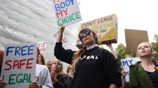 Demonstrators hold up signs outside the Irish Embassy in London, supporting calls for more liberal Irish abortion laws. Photograph: Mary Turner/Reuters