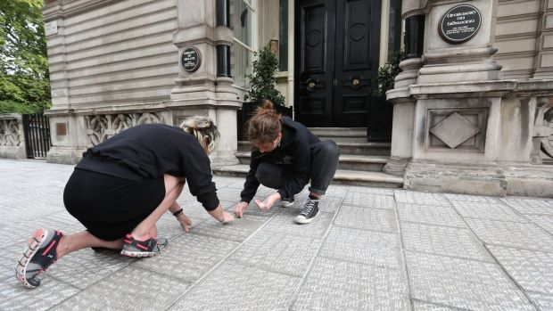 London-Irish Abortion Rights campaigners seek to chalk up more than 200,000 tally marks on the pavement outside the Irish Embassy in London, representing what they say is the number of Irish women who have travelled to England for abortions since 1983. Photograph: Jonathan Brady/PA Wire