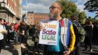 "Tim Redfern (48), who carried a ""free, safe legal"" poster, described the Eighth Amendment as a ""weeping sore"". Photograph: Ronan McGreevy"