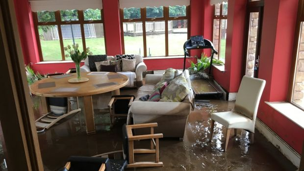 The dining room at Paul Bradley's house, built on a flood plain of the Burnfoot river in Co Donegal, August 2017. Climate change is increasing the risks of flash flooding in summers months, as had occurred in Donegal recently, Dr Peter Stott of the UK Met Office told the Citizens' Assembly. File photograph: Peter Murtagh/The Irish Times