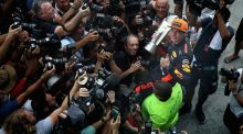 Race winner Max Verstappen   celebrates with his team after  the Malaysia Grand Prix. Photograph: Clive Mason/Getty Images