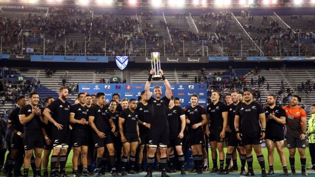New Zealand's captain Kieran Reid lifts up Rugby Championship trophy. Photograph: Marcos Brindicci/Reuters