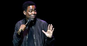 """Let me know when I tell a lie,"" Chris Rock says at one point, to dead silence.  Photograph: Ethan Miller/Getty Images"