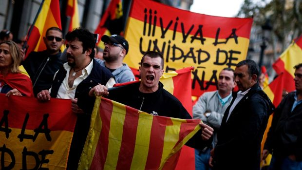 A protester shouts as he holds a Catalan flag during a demonstration called by far-right groups against a referendum on independence for Catalonia. Photograph: Pau Barrena/AFP/Getty Images