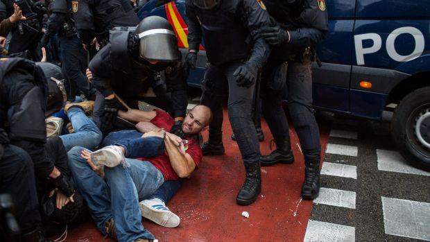 People clash with Spanish police officers outside the Ramon Llull polling station in Barcelona. Photograph: Fabio Bucciarelli/AFP/Getty Images