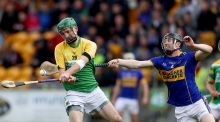 Kilcormac/Killoughey's Ciaran Slevin gets his shot away under pressure from Niall Wynne. Photograph: Bryan Keane/Inpho