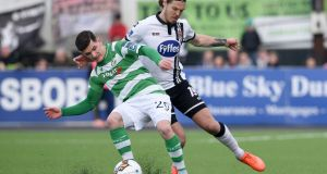 Dundalk's Niclas Vemmelund and Trevor Clarke of Shamrock Rovers in action in Sunday's semi-final. Photograph: Ciaran Culligan/Inpho