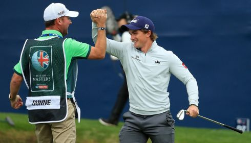 IRISH MASTER: Paul Dunne celebrates with his caddie Darren Reynolds after winning the British Masters, at Close House golf club, Newcastle upon Tyne. Photograph: Andrew Redington/Getty Images