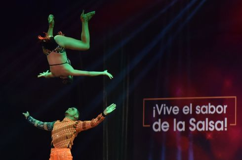 DANCE ON AIR: Angie Ramirez and Brayan Saldana compete during the World Salsa Festival, in Cali, Colombia. Photograph: Ernesto Guzman jnr/EPA