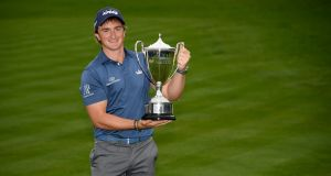 Paul Dunne of Ireland with the winner's trophy after the final round of the British Masters at Close House Golf Club in Newcastle upon Tyne, England. Photo: Ross Kinnaird/Getty Images