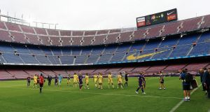Players leave the empty Camp Nou stadium after the Spanish Primera Division match between FC Barcelona and UD Las Palmas. Photograph: Alejandro Garcia/EPA
