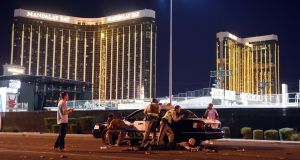 Las Vegas police stand guard along the streets outside the festival grounds of the Route 91 Harvest in Las Vegas, Nevada amids reports of an active shooter around the Mandalay Bay Resort and Casino. Photograph: David Becker/Getty Images