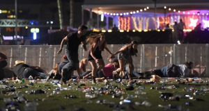 People run from the Route 91 Harvest country music festival after  gun fire was heard  in Las Vegas, Nevada. Photograph:David Becker/Getty Images