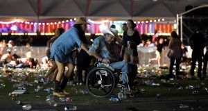 A man in a wheelchair is taken away from the Route 91 Harvest country music festival after  gunfire was heard. Photograph:  David Becker/Getty Images