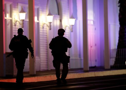 Metro Police officers pass by the front of the Tropicana hotel-casino. Photograph: Las Vegas Sun/Steve Marcus/Reuters