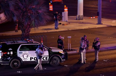 Las Vegas Metro Police officers gather near the intersection of Tropicana Avenue and Las Vegas Boulevard South. Photograph: Las Vegas Sun/Steve Marcus/Reuters